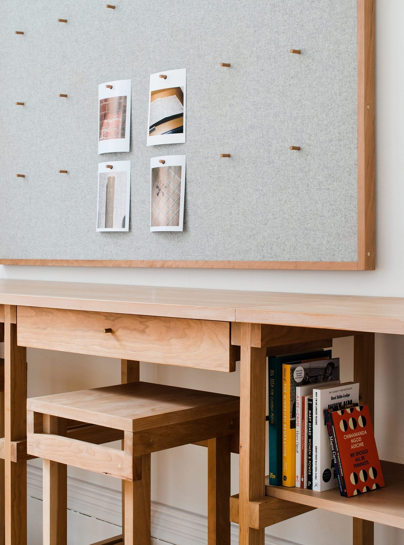Detailed view of the bespoke solid cherry, felt and brass fitted joinery and furniture designed by From Works at the National Justice Museum in Nottingham.