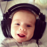 Baby laughing while listening on headphones