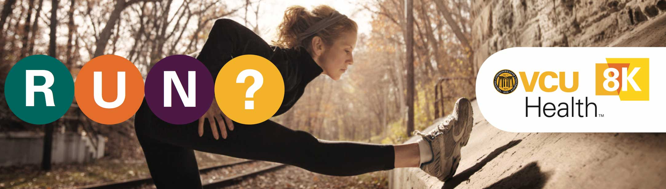 a woman is stretching along some railroad tracks