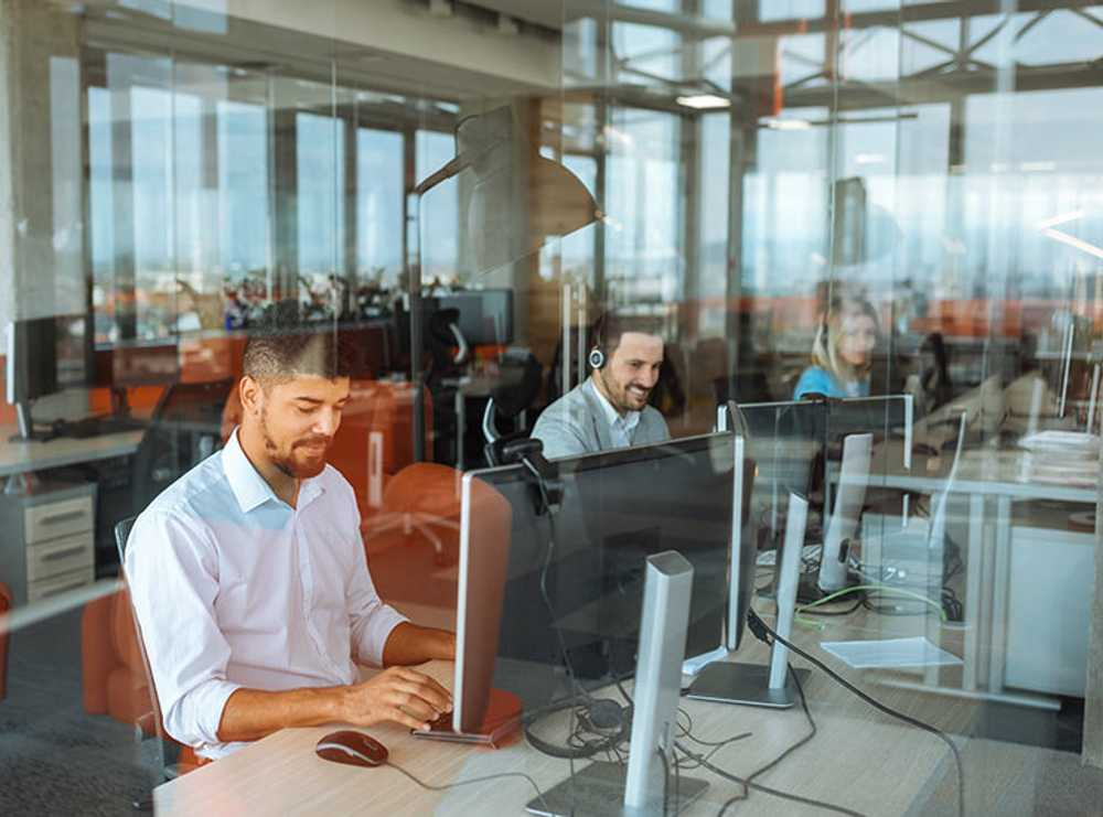 Accruent - Resources - Blog Entries - Understanding Desk Hoteling Software as a Smart Office Solution - Hero