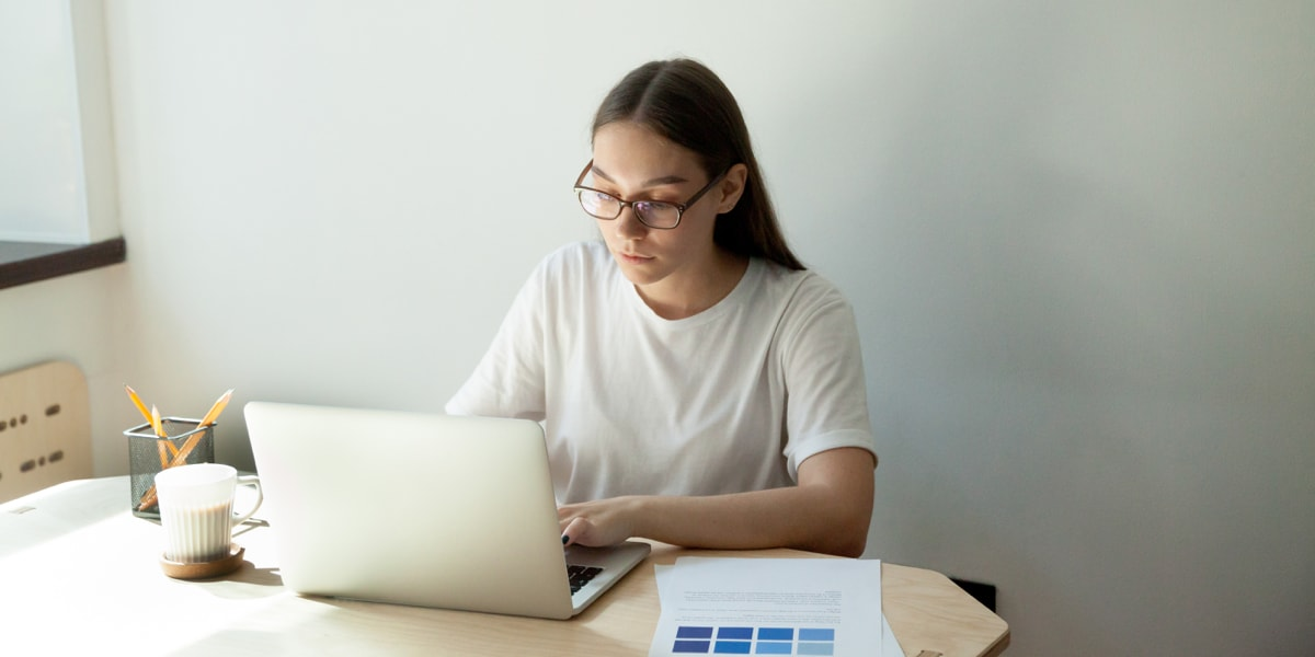 Woman sitting at a desk with a laptop in front of her