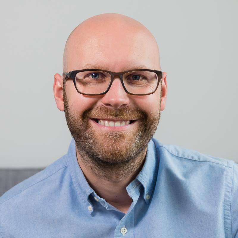 Bald guy smiling