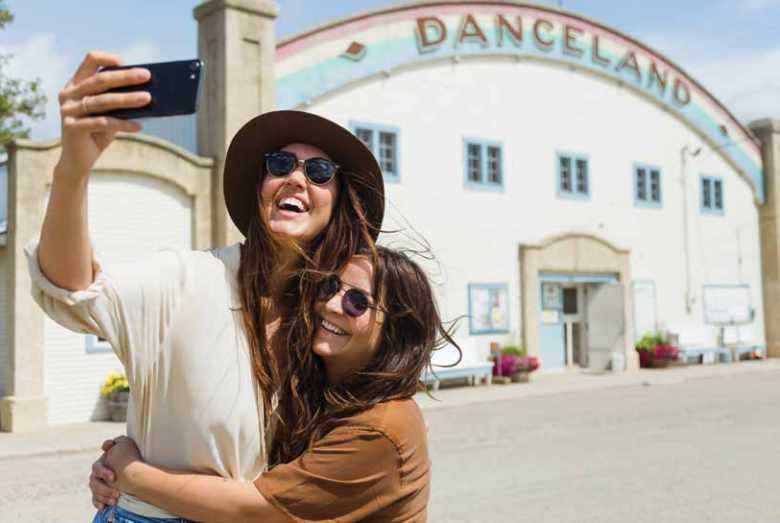 Two women outside danceland taking a selfie