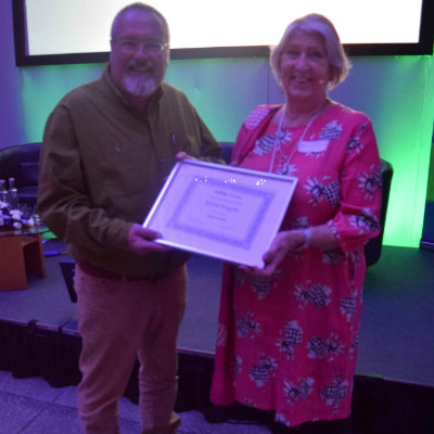 Sylvia Knights (Bungay Library) receives her Special Volunteer Award from Suffolk Libraries Board chair Tony Brown