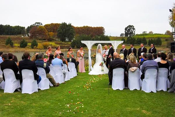 A wedding ceremony on the lawn near to the dam.