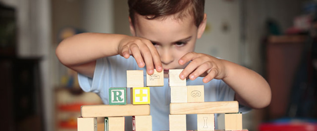 Child playing with wooden blocks   Play Therapy