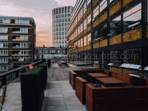 Outdoor Virtual Background for Zoom interior with benches on decking and sunset sky