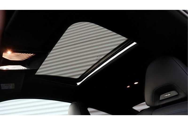 BMW 4 Serie Coupé M440i xDrive High Executive Harman/Kardon, Head Up Display, Schuifdak afbeelding 14