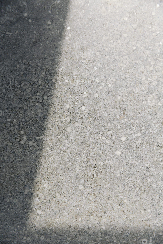 Sun shining upon the limestone grey worktop.