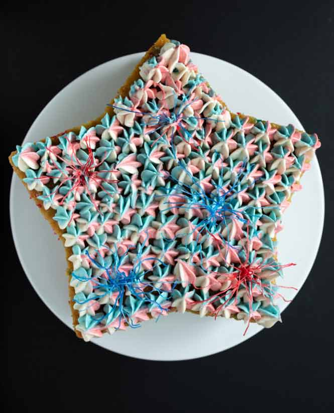 vegan funfetti lemonade cake with pastel red, white, and blue frosting