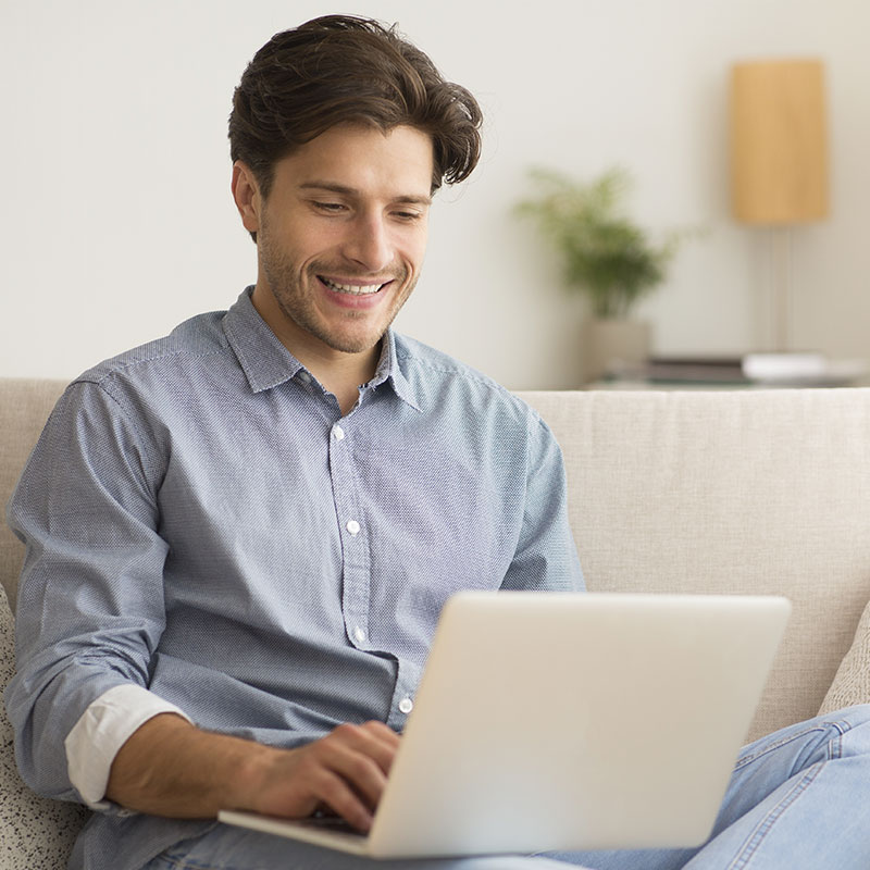 Photo of a young man getting online therapy from his room