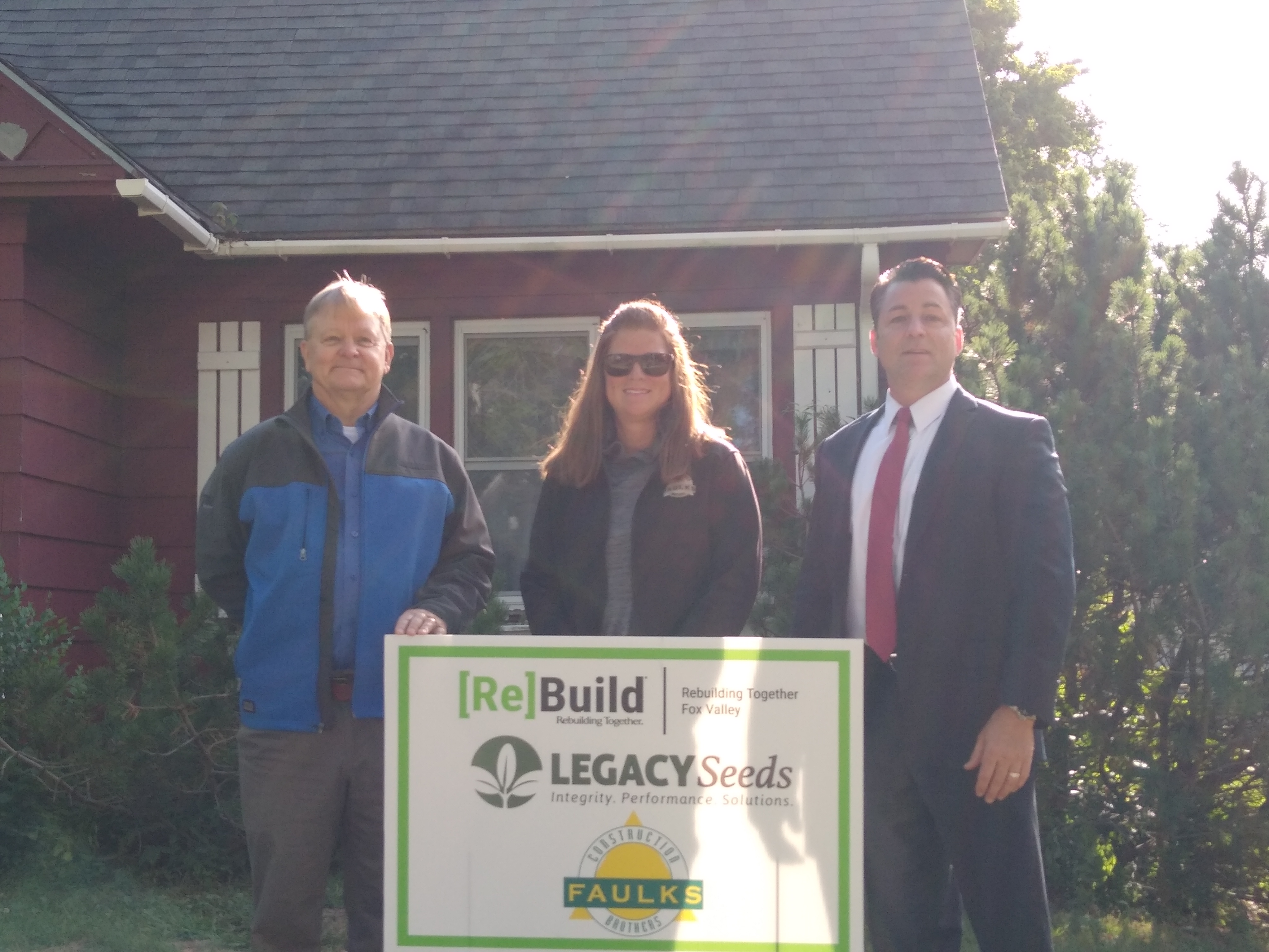 Legacy Seed Companies President Bruce Ceranske with representatives from Faulks Brothers Construction and Rebuilding Together Fox Valley