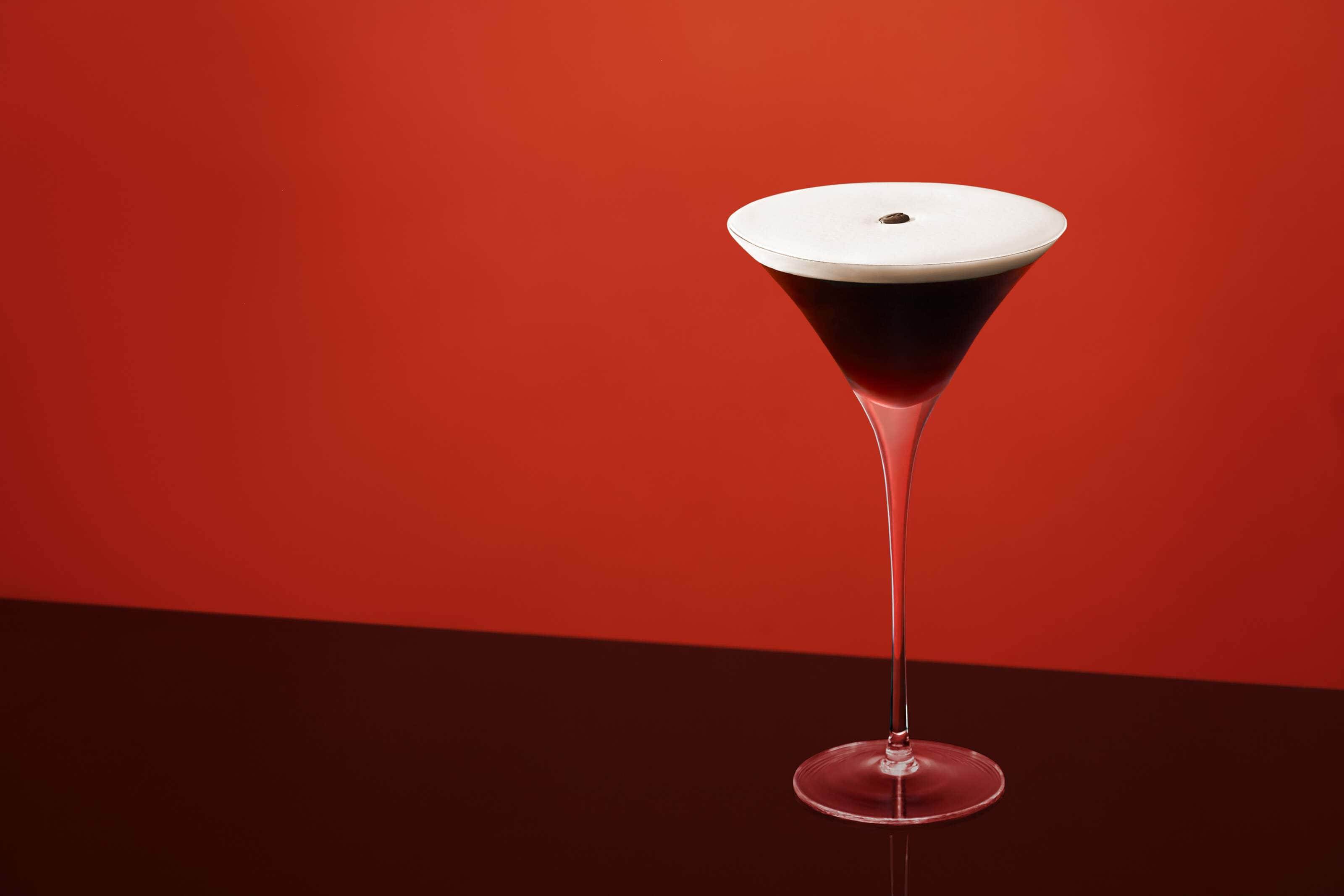 espresso_martini_standing on black perspex with red background