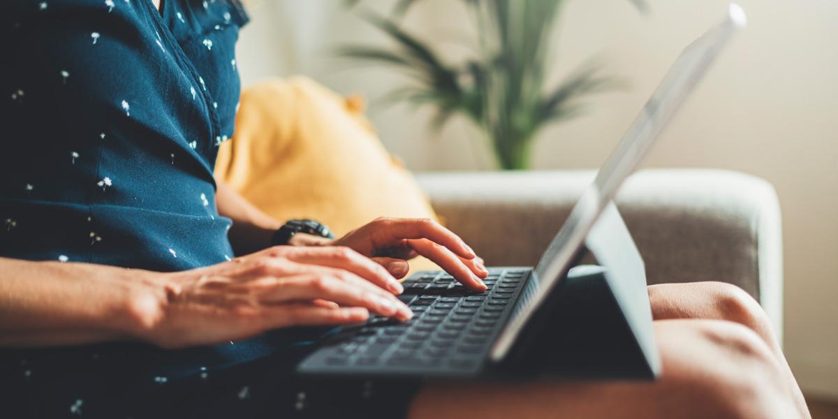 UX writer typing on laptop keyboard