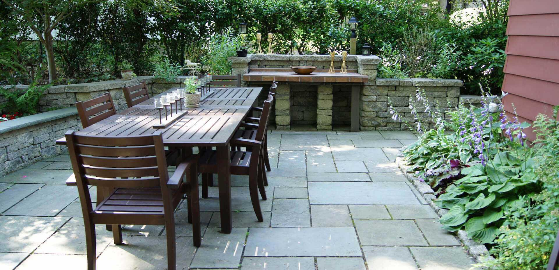 outdoor dining table with stone table on opposite side