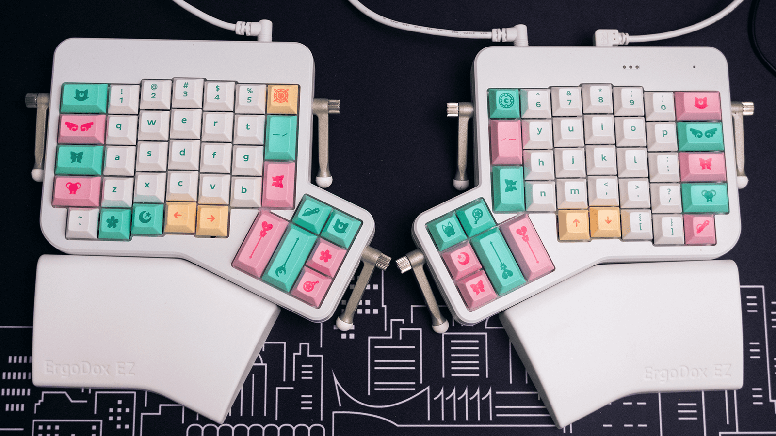 Overhead shot of my Ergodox split keyboard with white, pink, and mint keycaps.