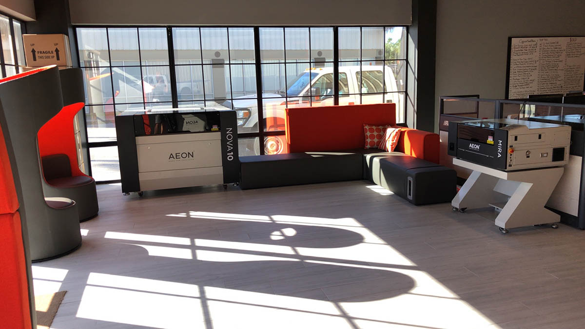 Aeon showroom with serveral lasers and natural light flowing in from the windows
