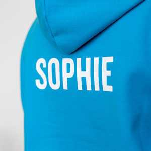 A trip hoodie with the student's individual name printed on the back
