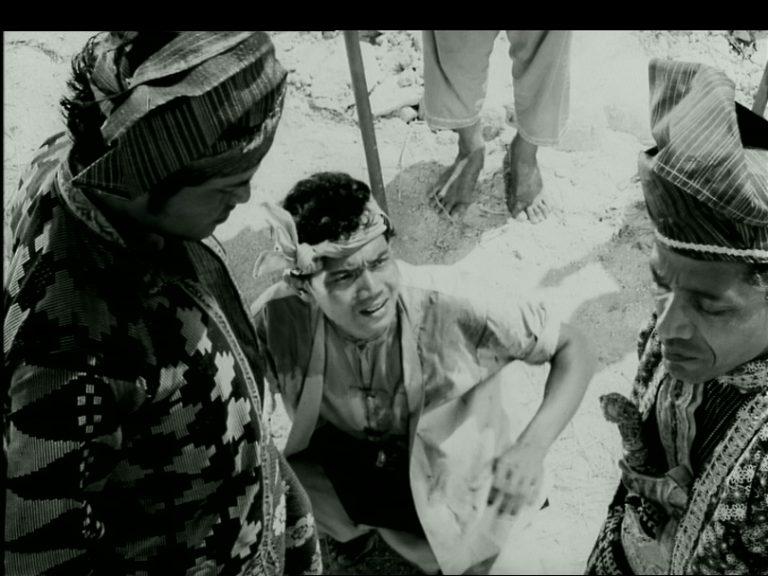 Film still from Hang Jebat. Three men are in the scene.