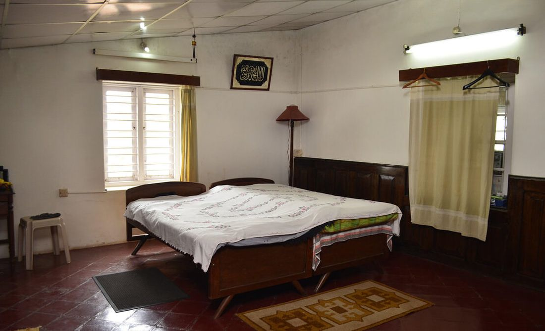 Spacious bedrooms with wooden wall panelling and clay tiled floors