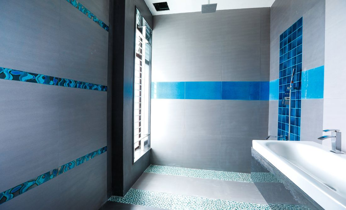 A bathroom in the house. Several bathrooms are done with high quality tiles