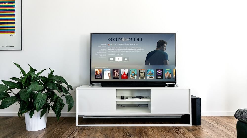 image of flat screen tv showing movie selections