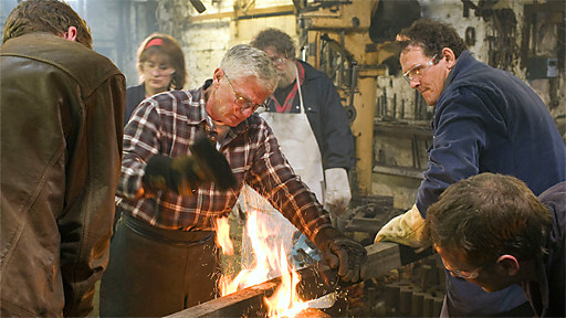 blacksmith forging metal