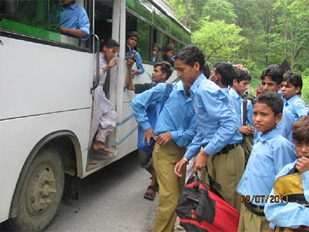 School children boarding the bus at Sunderkhal  village near the tiger reserve
