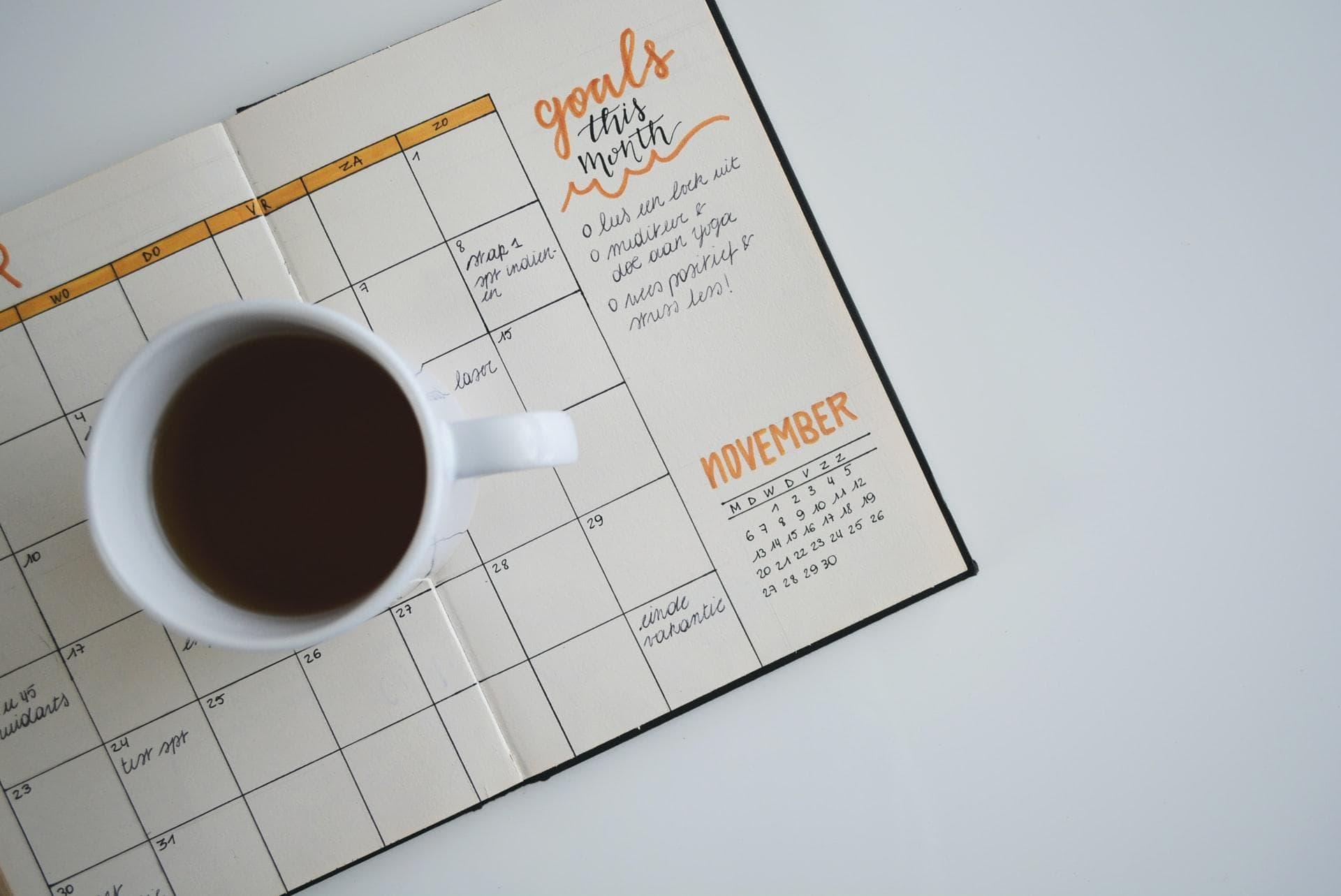 Coffee mug on calendar