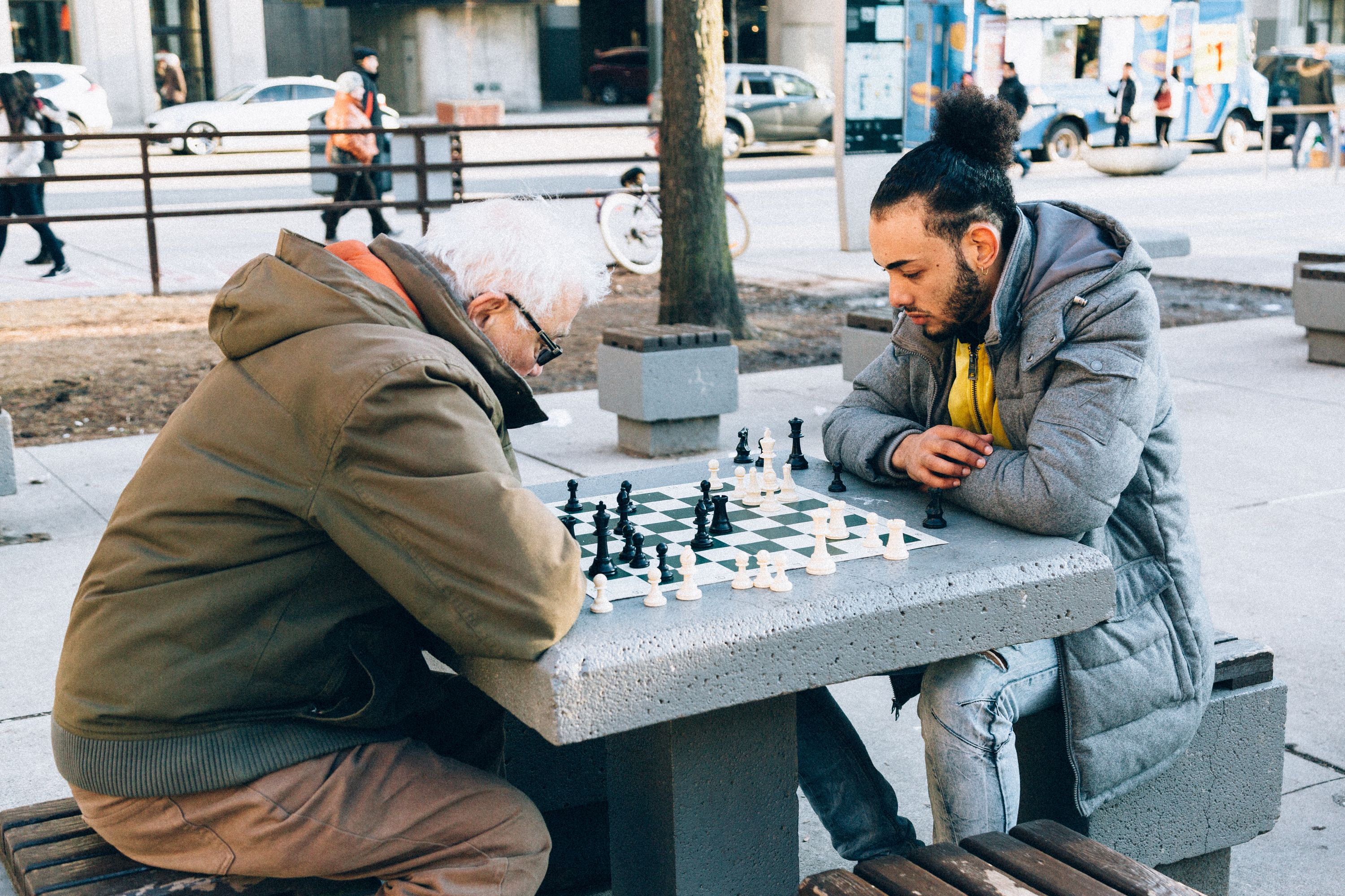 Teen Boy and Man Playing Chess
