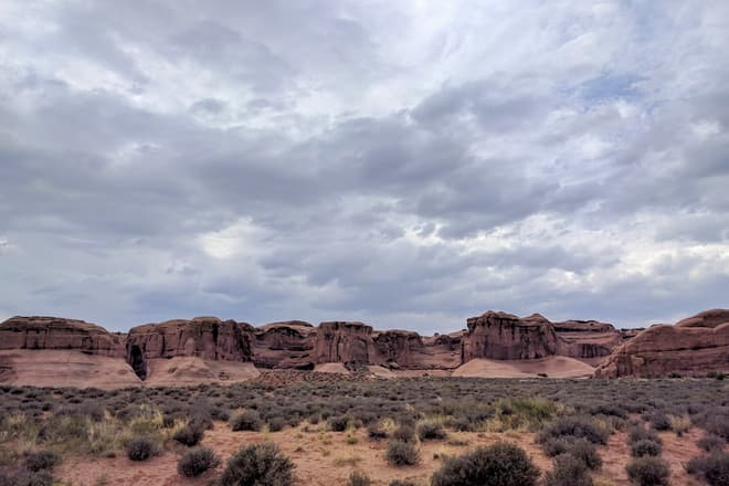 The undulating wall of a mesa near the entrance to Arches National Park.