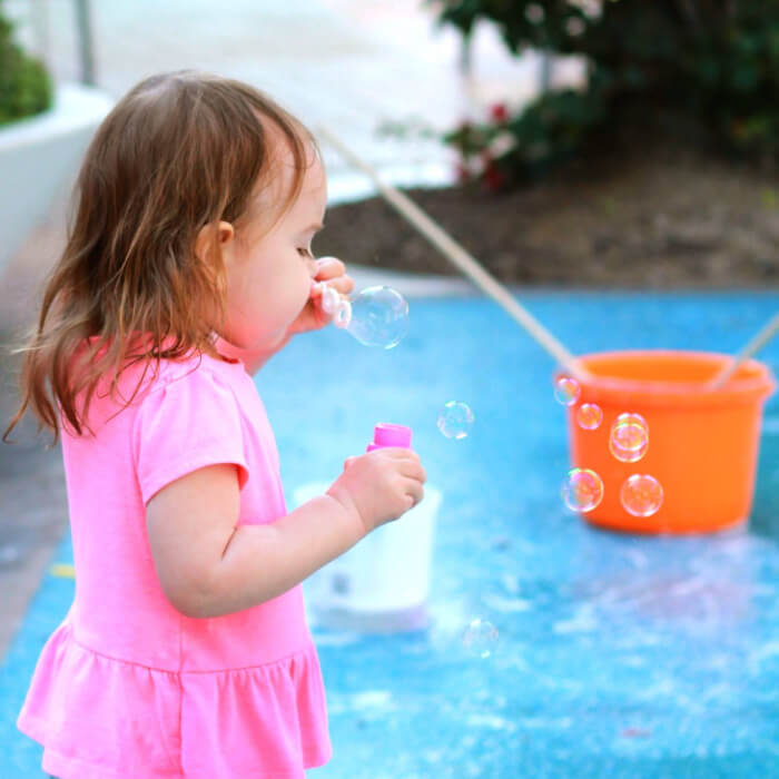 Baby blowing bubbles.