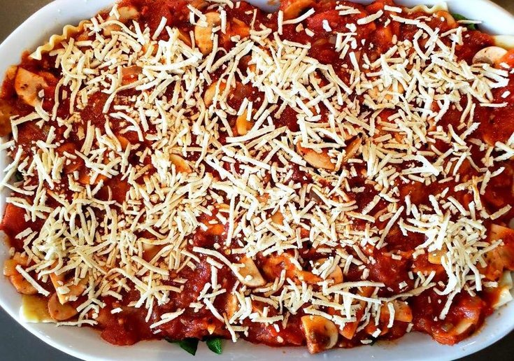 Casserole dish with lasanga topped with vegan cheese