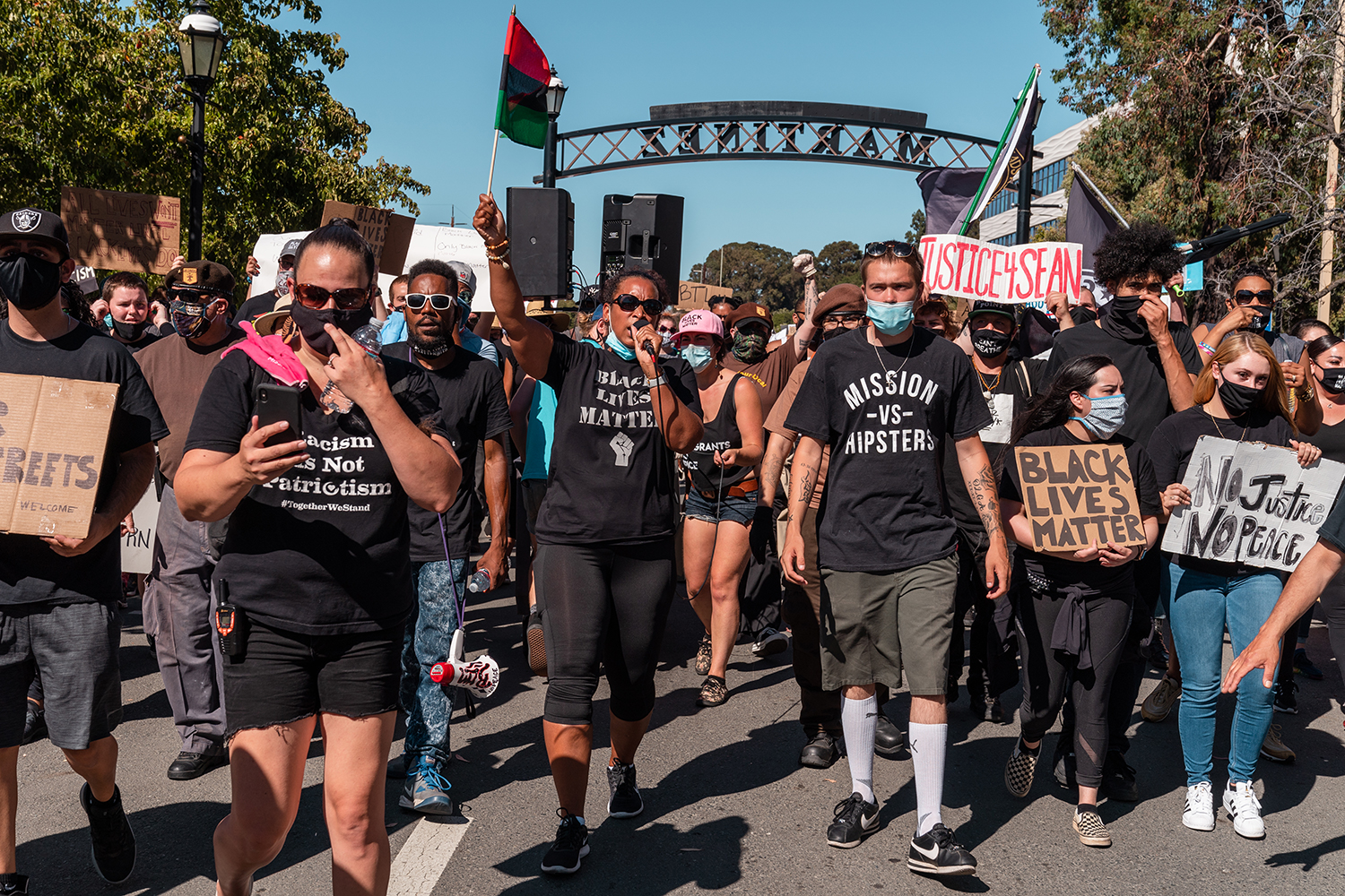 "Protesters march to the Waterfront Park during the ""Zero Tolerance for White Supremacy"" protest in Martinez, Calif., on Sunday, July 12, 2020."