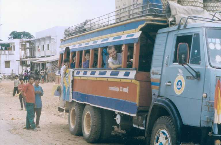 Boarding a truck-turned-bus in Laos (1994)