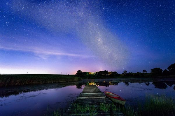 View of the stars above the dam at night.