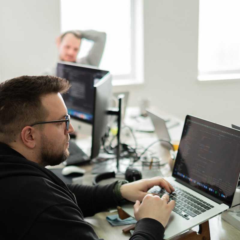 Codempire developers work in open space room