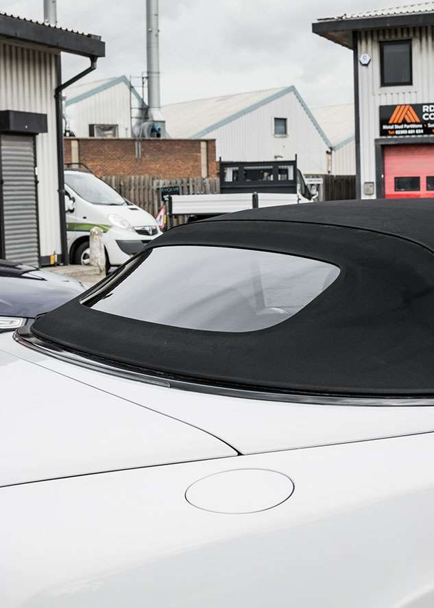 Close shot of Bentley Continental GT car with untinted windows from front