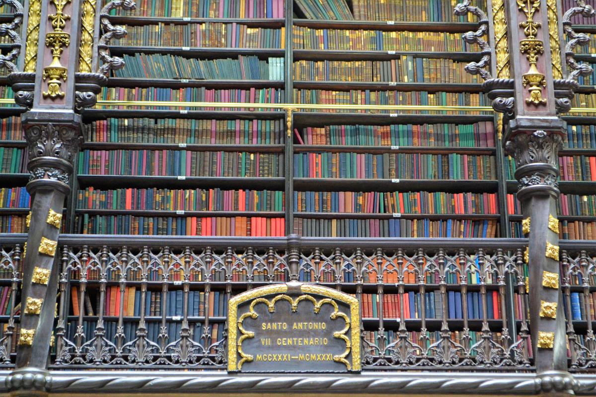 gilt-edged bookshelves in the royal portuguese reading room