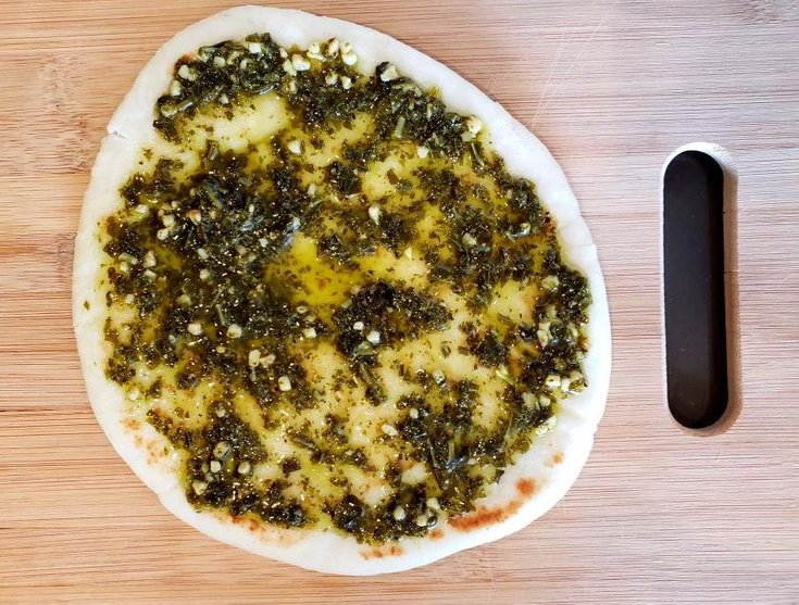 Flatbread with basil pesto sauce on top