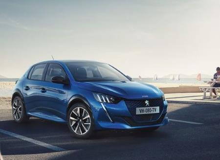 Manufacturer image of the Peugeot e208 in the foreground with artistic sea and boats in the background.
