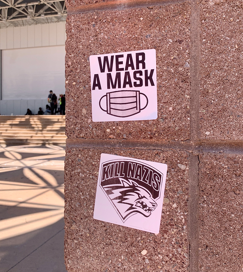 Stickers put up at the plaza on July 19. The bottom sticker transposes the phrase 'Kill Nazis' on the University of New Mexico lobos emblem.