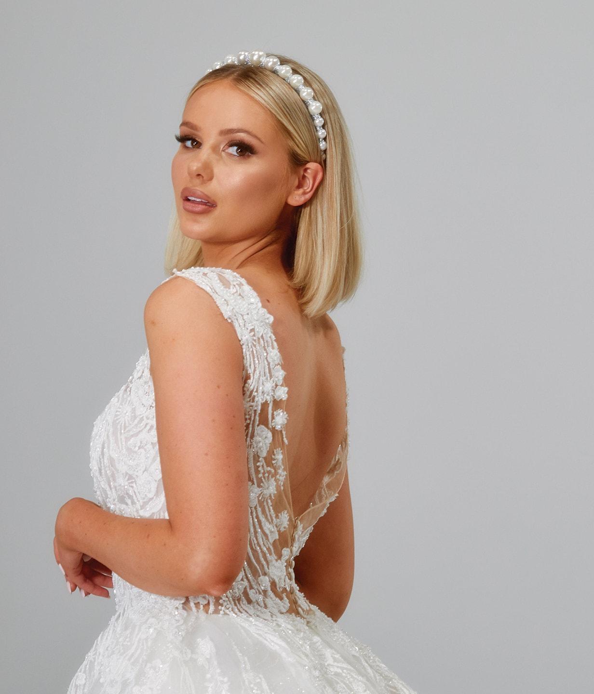 Women posing in white wedding dress