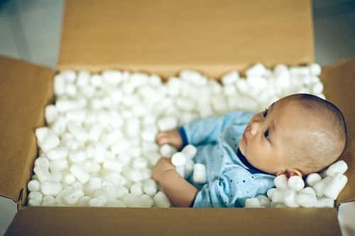 baby in a packing box
