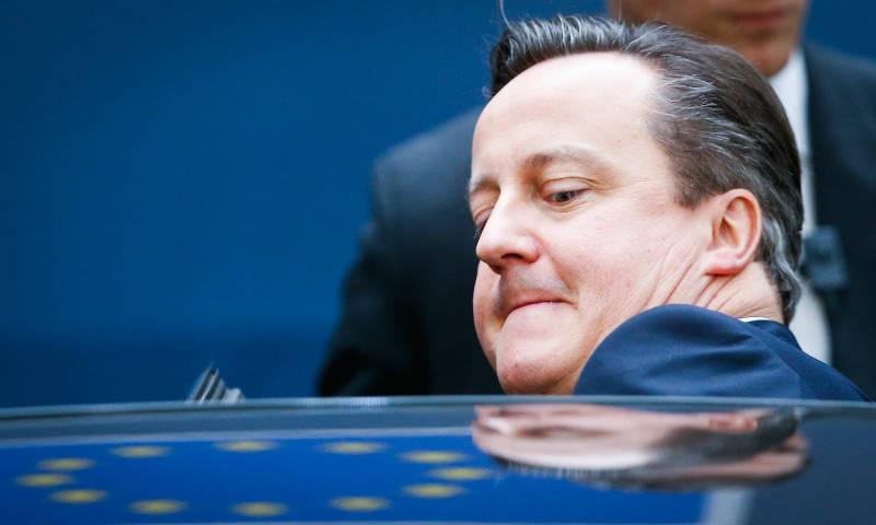 David Cameron ducking into a car