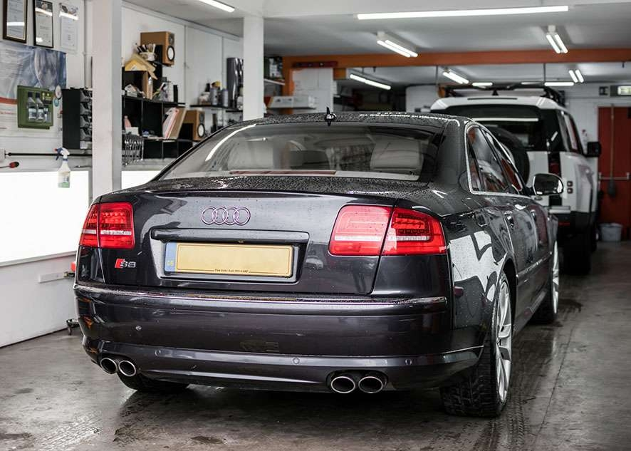 Audi s8 car inside garage/studio with untinted windows from back