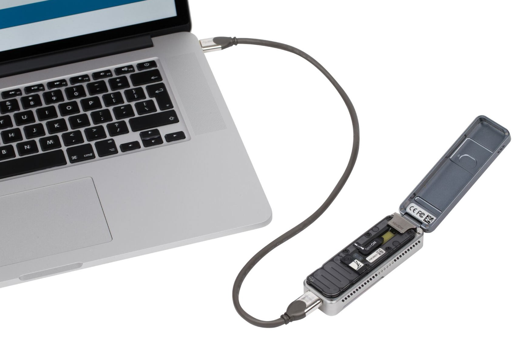 The MinION device, a small, handheld device that can sequence a person's genome, is plugged into a laptop to transfer data