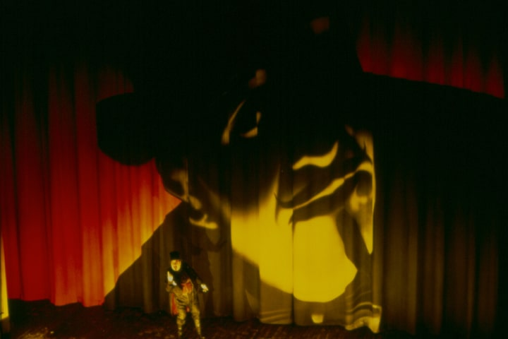 """Robert Thomson's lighting design for the Canadian Opera Company's production of """"Mario and the Magician""""."""