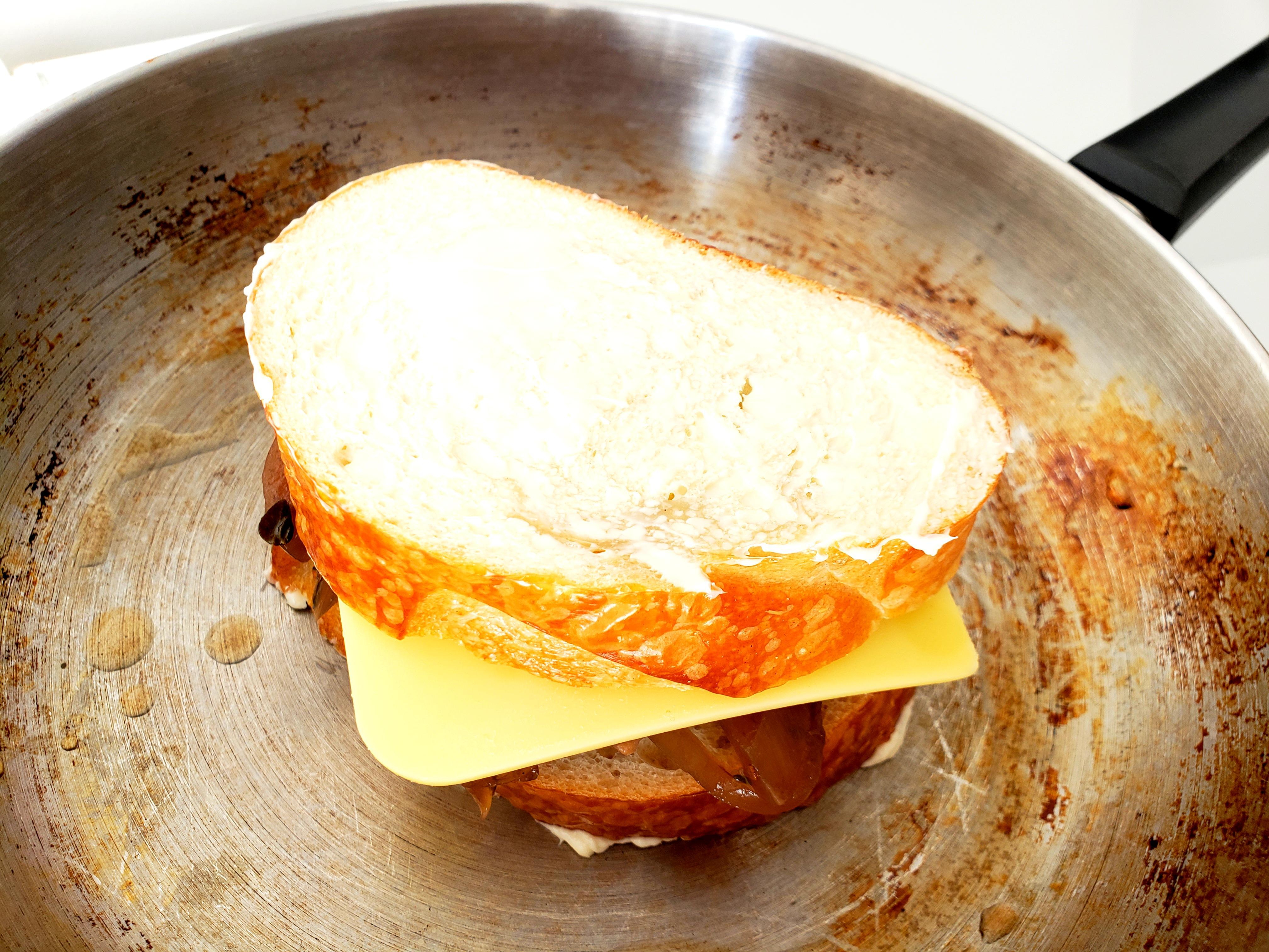 Cooking Grilled Cheese Sandwich with onions