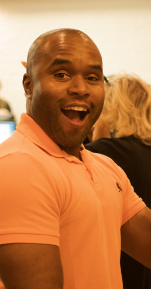 A photo of a male Adcetera employee smiling at the camera